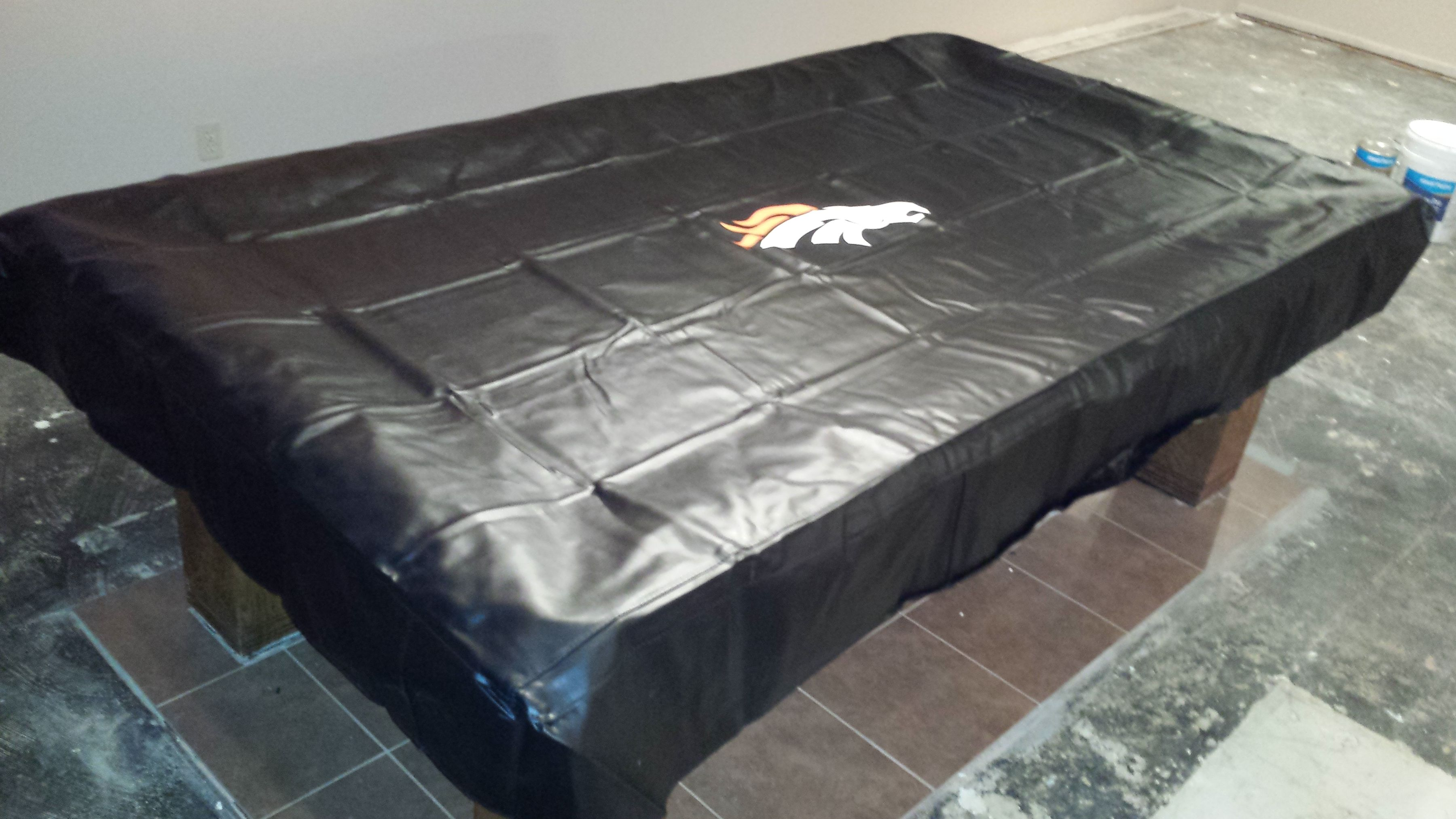 & Denver Broncos pool table cloth on an 8 foot Brunswick pool table.